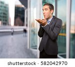 happy businessman sending a kiss | Shutterstock . vector #582042970