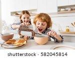 humorous cute siblings fooling... | Shutterstock . vector #582045814