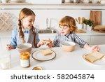 lovely siblings sharing freshly ... | Shutterstock . vector #582045874