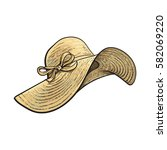 fashionable straw hat with wide ... | Shutterstock .eps vector #582069220