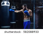 active man in boxing glowes | Shutterstock . vector #582088933