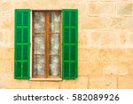 mediterranean window with green ... | Shutterstock . vector #582089926