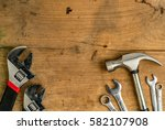 adjustable wrench and hammer on ...   Shutterstock . vector #582107908