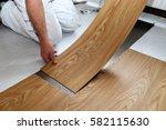 man laying pvc floor | Shutterstock . vector #582115630