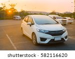 Stock photo cars parked in outdoor parking lot at a park in the evening time with sunlight of sunset and 582116620