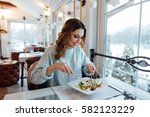 smiling woman eating fresh... | Shutterstock . vector #582123229