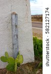 Small photo of Adobe Brick Gate Marfa West Texas Prickly Pear Cactus Road Vista Sky Cloud