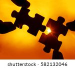 two hands trying to connect... | Shutterstock . vector #582132046