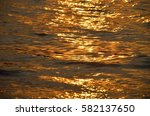 Golden Waves In A Sea At Sunset