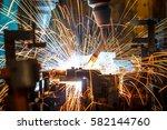 welding robots movement in a... | Shutterstock . vector #582144760
