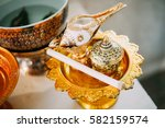 Small photo of Conch shell adorned with candle on gold tray use for Pour water In traditional thai ceremony.