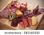 charcuterie board with cured... | Shutterstock . vector #582160330