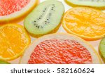 sliced fruit on a white... | Shutterstock . vector #582160624