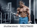 muscular man working out in gym ... | Shutterstock . vector #582178600