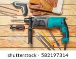 electric hammer drill lies on a ... | Shutterstock . vector #582197314