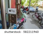 Small photo of SHANGHAI, CHINA - MAY 04, 2016: Apple pay logo on small shop in Shanghai