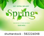 Spring word on natural green background.Spring sale.Vector illustration EPS10 | Shutterstock vector #582226048