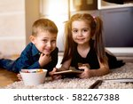adorable little brother and... | Shutterstock . vector #582267388