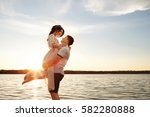 couple embracing on sea or... | Shutterstock . vector #582280888