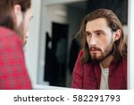 handsome bearded young man in... | Shutterstock . vector #582291793