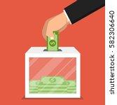 hand putting money in donation... | Shutterstock .eps vector #582306640
