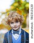 handsome little boy in jacket...   Shutterstock . vector #582313120