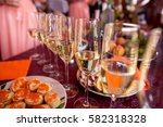 champagne glasses on table.... | Shutterstock . vector #582318328