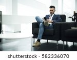 skilled well dressed... | Shutterstock . vector #582336070