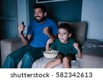 father and son watching tv and... | Shutterstock . vector #582342613