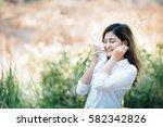 asian woman traveller drink... | Shutterstock . vector #582342826