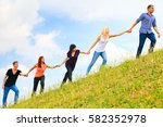 young people helping each other ...   Shutterstock . vector #582352978