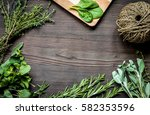 fresh herb frame on dark wooden ... | Shutterstock . vector #582353596