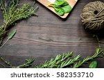 fresh herb frame on dark wooden ... | Shutterstock . vector #582353710
