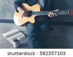 coffee play guitar write song | Shutterstock . vector #582357103