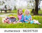 little children eating lunch... | Shutterstock . vector #582357520