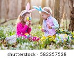 kids on easter egg hunt in... | Shutterstock . vector #582357538
