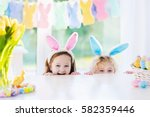 boy and girl in bunny ears at... | Shutterstock . vector #582359446