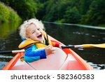 Happy Kid Enjoying Kayak Ride...