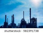 refinery storage tanks in the... | Shutterstock . vector #582391738