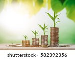 coin stacks on a green... | Shutterstock . vector #582392356