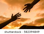 giving a helping hand.  | Shutterstock . vector #582394849