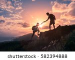 people helping each other hike... | Shutterstock . vector #582394888