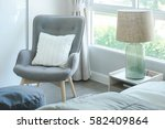 gray armchair with pillow at... | Shutterstock . vector #582409864