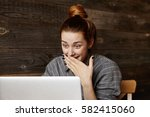 surprised beautiful redhead... | Shutterstock . vector #582415060
