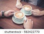 hands of couple drinking coffee ... | Shutterstock . vector #582422770