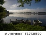 the morning sun on the lake in... | Shutterstock . vector #582425530