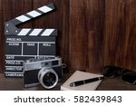 old camera with clapper movie... | Shutterstock . vector #582439843