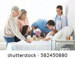 family visiting little girl in... | Shutterstock . vector #582450880