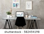 workplace with laptop on table... | Shutterstock . vector #582454198