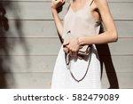 woman's hands holding beige... | Shutterstock . vector #582479089